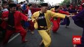 Minggu pagi yang meriah di sekitar kawasan Menteng, Jakarta Pusat, kala digelar Pangsi Betawi yang menampilkan atraksi seribu pendekar silat.