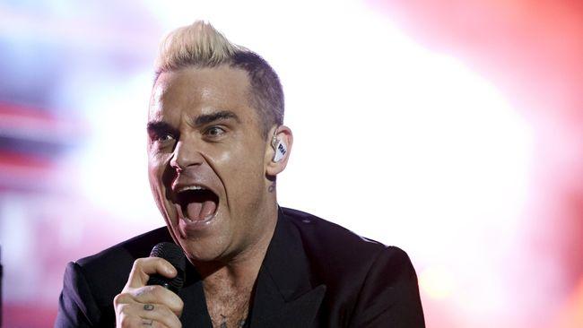 Robbie Williams disebut 'jual jiwa' ke Rusia oleh pebisnis dan beberapa anggota parlemen Inggris, karena tampil di Piala Dunia dan menjadi 'humas' bagi Putin.