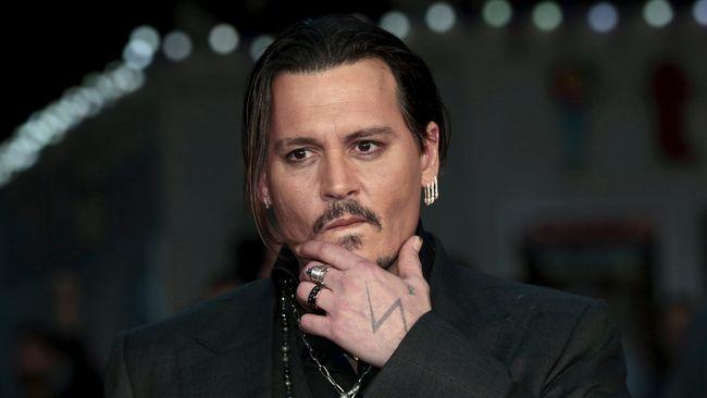 Telah merilis pernyataan bersama di luar gedung pengadilan, bukan berarti masalah antara Johnny Depp dan Amber Heard berakhir.