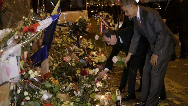 Presiden AS Barack Obama mengunjungi lokasi serangan Paris ketika tiba di kota itu untuk menghadiri KTT Perubahan Iklim.