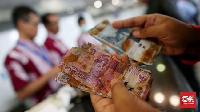 BI kembali membuka layanan penukaran uang rupiah yang rusak. Berikut cara dan syarat tukar uang rupiah yang sobek dan uang logam.
