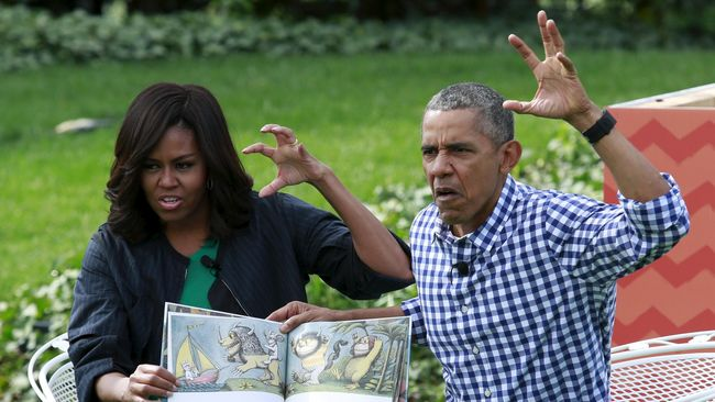 Barack Obama dan Michelle Obama menghiasi National Portrait Gallery hingga November. Masing-masing dilukis oleh dua seniman berbeda.