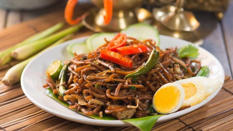 Chinese style fried noodle with fish ball on white isolated background