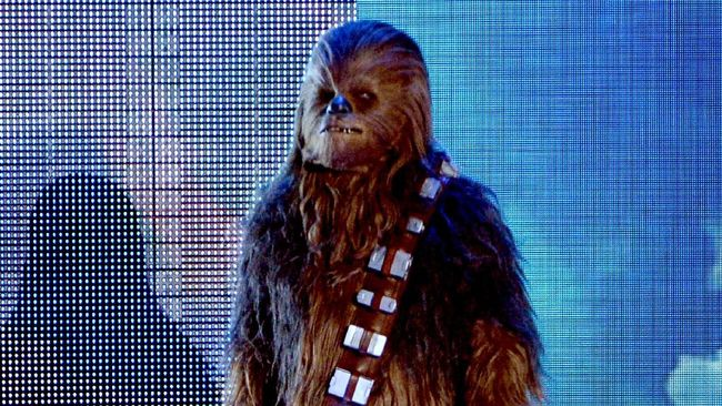 Para astronaut punya cara sendiri memberikan penghormatan kepada mendiang aktor Peter Mayhew, pemeran asli Chewbacca, yang meninggal 30 April lalu.