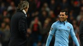 """Manchester City's Argentinian forward Carlos Tevez (R) speaks to Manchester City's Italian manager Roberto Mancini (L) after being substituted during the English FA Cup quarter-final football match between Manchester City and Barnsley at the Etihad Stadium in Manchester, north-west England, on March 9, 2013. Manchester City won 5-0. AFP PHOTO/ANDREW YATES  RESTRICTED TO EDITORIAL USE. No use with unauthorized audio, video, data, fixture lists, club/league logos or """"live"""" services. Online in-match use limited to 45 images, no video emulation. No use in betting, games or single club/league/player publications. / AFP PHOTO / ANDREW YATES"""