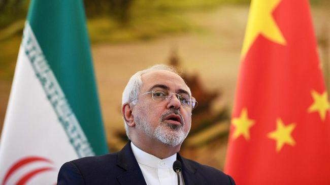 Menlu Iran, Javad Zarif, memperingatkan 'konsekuensi menyakitan bagi semua orang' jika Amerika Serikat berani memperkeruh ketegangan dengan negaranya.