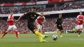 Sempat dua kali unggul, Manchester City hanya membawa pulang satu poin saat bertandang ke markas Arsenal. Berikut ini foto aksi-aksi jalannya pertandingan.