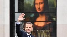 Presiden Prancis Diadang Demonstran saat Jalan-jalan di Taman