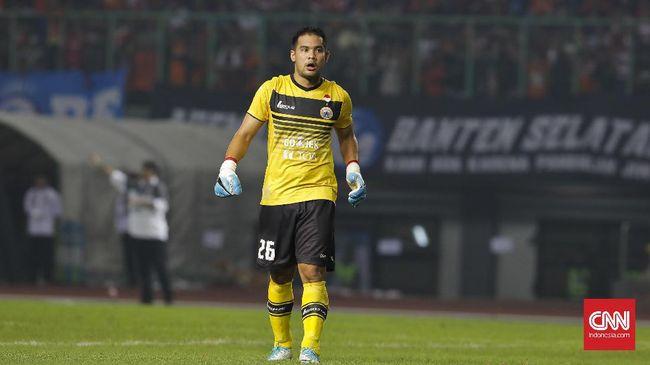 Kiper Persija Jakarta Andritany Ardhiyasa banjir pujian usai tampil heroik saat membawa Macan Kemayoran ke final Piala Menpora 2021, Minggu (18/4) malam.