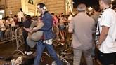 Niat Juventini menyambut kemenangan tim sepak bola favorit mereka di Turin, Italia, berubah bencana ketika ledakan terjadi di tempat 'nobar' usai kekalahan.