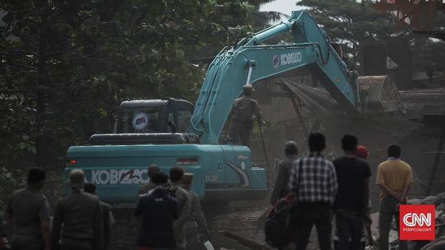 Penggusuran rumah warga Pancoran, Jakarta Selatan, disertai dugaan intimidasi oleh preman dan aparat Brimob. PT Pertamina mengklaim sebagai pemilik lahan.