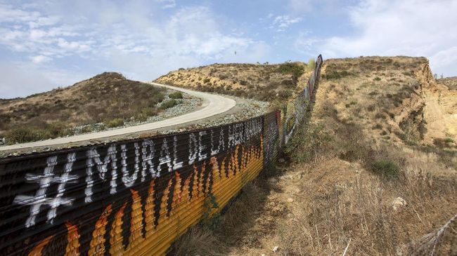 Partial view of the US-Mexico border wall painted by members of the Brotherhood Mural organization in Tijuana, Mexico on July 6, 2017. 