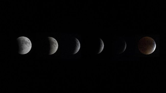 This composite image shows the progression of the total lunar eclipse to a Blood Moon in Centreville, MD, September 27, 2015.     AFP PHOTO/JIM WATSON / AFP PHOTO / JIM WATSON