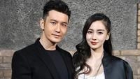 <p>Adapun istri dari aktor Huang Xiaoming adalah artis terkenal Angelababy yang kecantikannya tak perlu diragukan lagi. Menikah pada 2015, keduanya kini telah dikaruniai anak laki-laki. (Foto: Getty Images)</p>