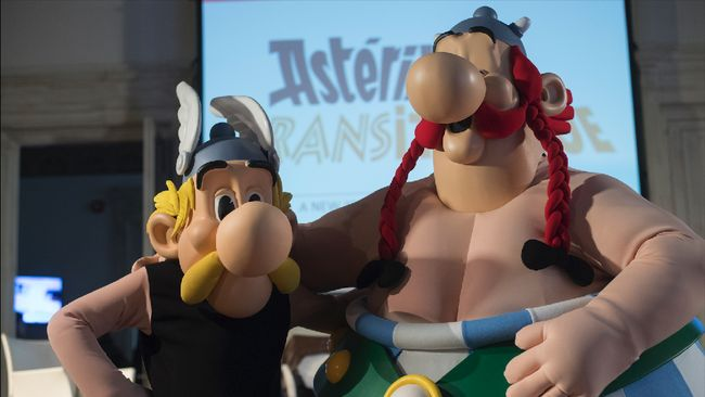 French comics characters Asterix and Obelix (R) pose during a press conference to present