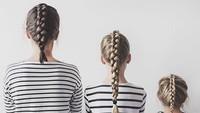 <p>Atau bisa juga hanya dengan mengepang rambut dengan gaya yang sama, pakai baju kembaran, lalu memunggungi kamera. Cekrek! (Foto: Instagram @allthatisshetagram)</p>