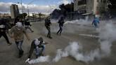 Protes yang diwarnai kekerasan pecah di sejumlah wilayah Palestina menyusul pengakuan Yerusalem sebagai ibu kota Israel. Sebanyak 31 warga terluka.