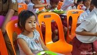 <p>Sudah kenyang, Nak? (Foto: Nurvita Indarini)</p>