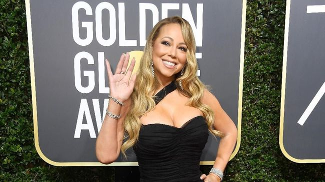 Mariah Carey mengenalkan album barunya setelah empat tahun dengan sebuah lagu 'ringan' tentang ia yang tak tertarik lagi dengan kedatangan sang mantan.