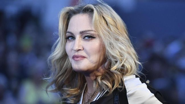 US singer-songwriter Madonna poses arriving on the carpet to attend a special screening of the film