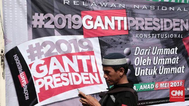Polisi menangkap delapan orang dari FPI yang meneriakkan 'ganti presiden' dan mengacungkan dua jari di acara tablig akbar dan tausiah kebangsaan NU.