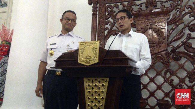 Anies Baswedan dan Sandiaga Uno saat Pilgub DKI 2017 mengumbar janji menjual saham di PT Delta Djakarta, hingga hari ini tak kunjung terealisasi.
