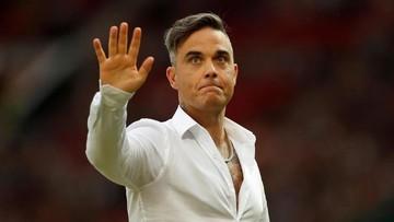 Alasan Manis Robbie Williams Sering Melukis Bareng Anak