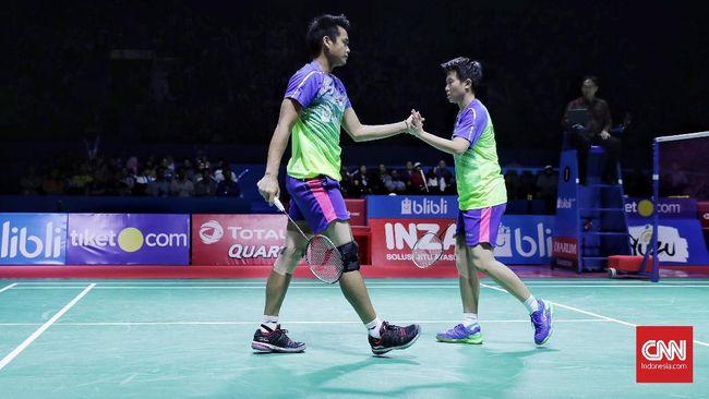 Tontowi Ahmad/Liliyana Natsir harus menelan kekalahan saat menghadapi Zheng Siwei/Huang Yaqiong di babak semifinal Denmark Terbuka.