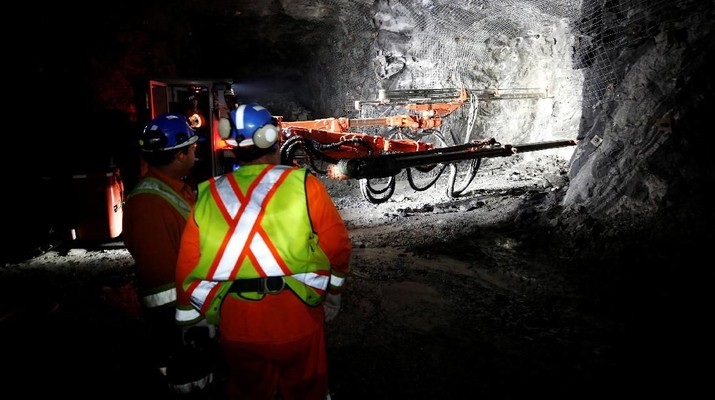 Workers watch an electric jumbo drill at Goldcorp Inc's Borden all-electric underground gold mine near Chapleau, Ontario, Canada, June 13, 2018. REUTERS/Chris Wattie
