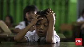 FOTO: Ekspresi Para Bocah di Hari Pertama Sekolah