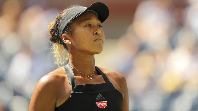 NEW YORK, NY - SEPTEMBER 05: Naomi Osaka of Japan reacts during her women's singles quarter-final match against Lesia Tsurenko of Ukraine on Day Ten of the 2018 US Open at the USTA Billie Jean King National Tennis Center on September 5, 2018 in the Flushing neighborhood of the Queens borough of New York City.   Elsa/Getty Images/AFP