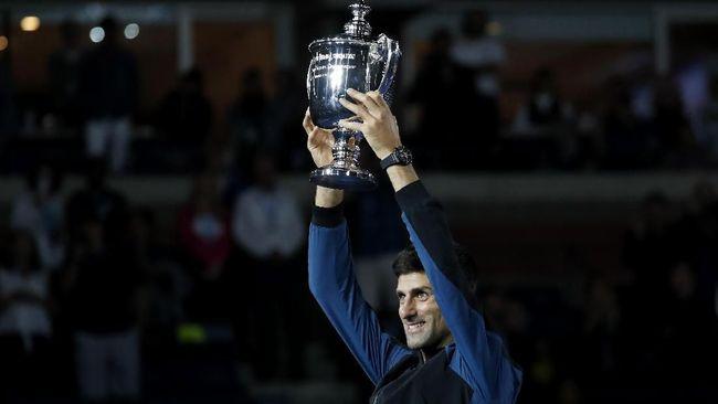 Novak Djokovic merasa berutang kepada Roger Federer dan Rafael Nadal setelah meraih gelar Amerika Serikat Terbuka 2018 atau gelar ke-14 di ajang Grand Slam.
