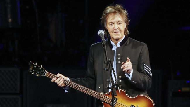 (FILES) In this file photo taken on July 26, 2017 Sir Paul McCartney performs in concert during his One on One tour at Hollywood Casino Amphitheatre in Tinley Park, Illinois.