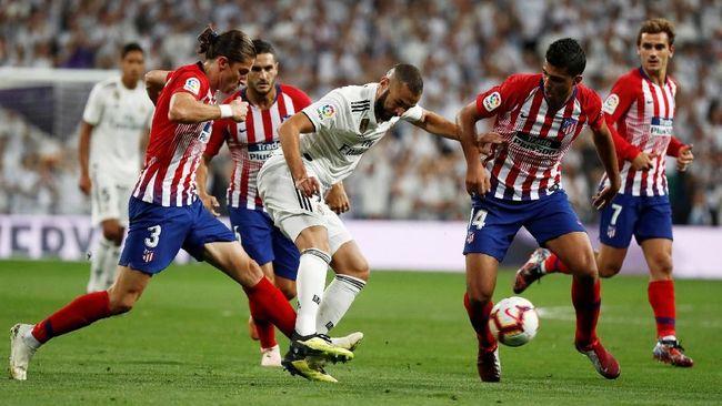 Atletico Madrid akan menjamu Real Madrid dalam laga La Liga di Stadion Wanda Metropolitano, Sabtu (9/2). Berikut prediksi jalannya Derby Madrid.