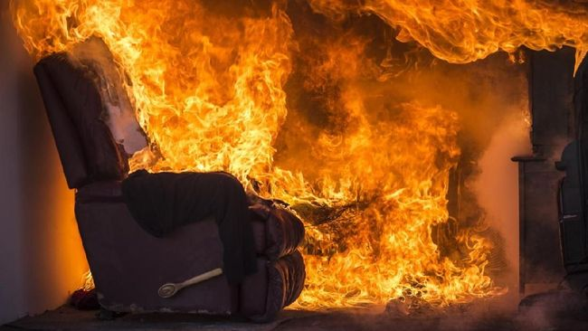 Living Room On Fire.  This stock image has a horizontal composition.
