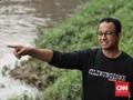 Jokowi Prioritaskan Warga, Anies Fokus Evakuasi dari Banjir