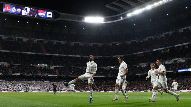 Pelatih Real Madrid Santiago Solari sukses meniru strategi Zinedine Zidane sebagai kunci kemenangan atas Valencia dalam lanjutan La Liga Spanyol, Minggu (2/12).