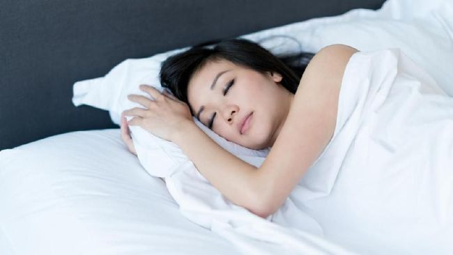 Asian woman sleeping in bed at home and looking very peaceful - lifestyle concepts