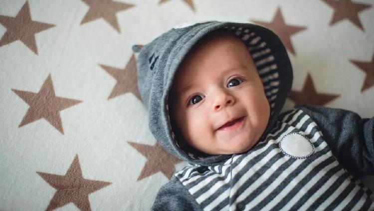 Adorable and happy baby boy.