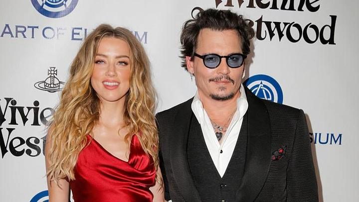 <p>Johnny Depp pertama kali bertemu Amber Heard di film The Rum Diary tahun 2011 lalu. Keduanya lalu menjalin kasih dan menikah pada 3 Februari 2015. (Foto: Alison Buck/Getty Images)</p>