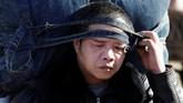 Jutaan penduduk China telah memulai mudik Tahun Baru Imlek, yang menjadi migrasi manusia tahunan terbesar di dunia.