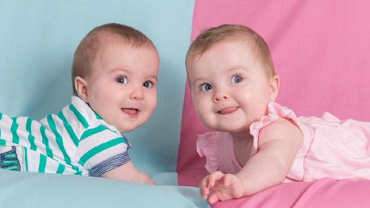 brother and sister - twins babies girl and boy on pink and blue background