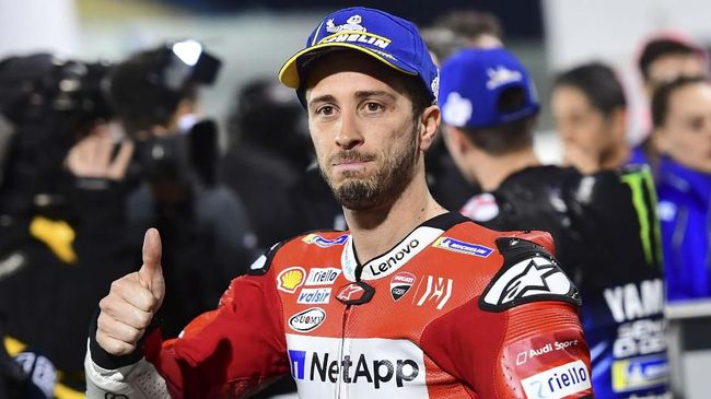 Mission Winnow Ducati's rider Andrea Dovizioso celebrates the second position at the end of the qualification session at Losail track in Doha on March 9, 2019 ahead of the season's start at Qatar MotoGP grand prix on March 10. (Photo by GIUSEPPE CACACE / AFP)