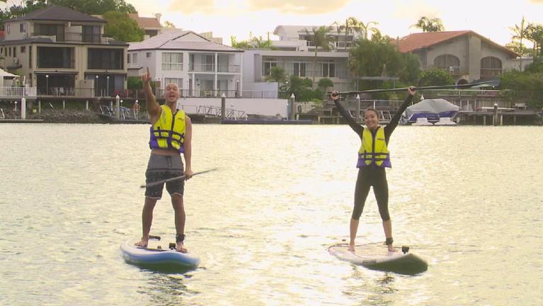 Adrenalin dua host MTMA masih diuji di Budds Beach. Mereka akan bersaing main paddle board sambil menikmati suasana perkotaan Queensland.