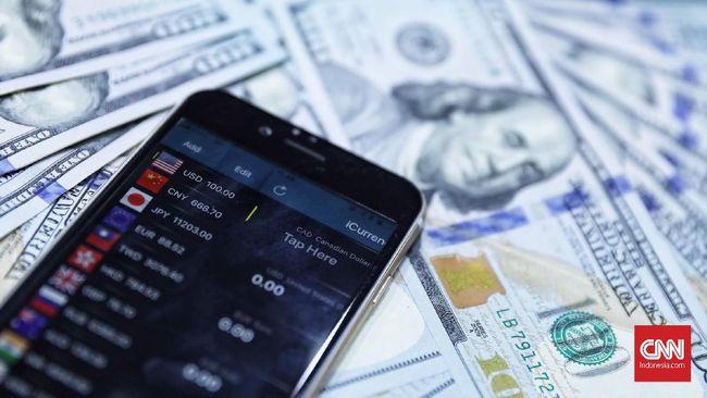 Nilai tukar rupiah berada di posisi Rp14.002 per dolar AS pada perdagangan pasar spot, Jakarta, 18 April 2019. Rupiah melesat 0,59 persen terhadap dolar AS dibandingkan Selasa (16/4) di angka Rp14.085 per dolar AS. (CNN Indonesia/ Hesti Rika)