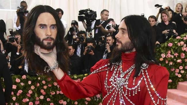 Jared Leto, holding a model of his own head, attends The Metropolitan Museum of Art's Costume Institute benefit gala celebrating the opening of the