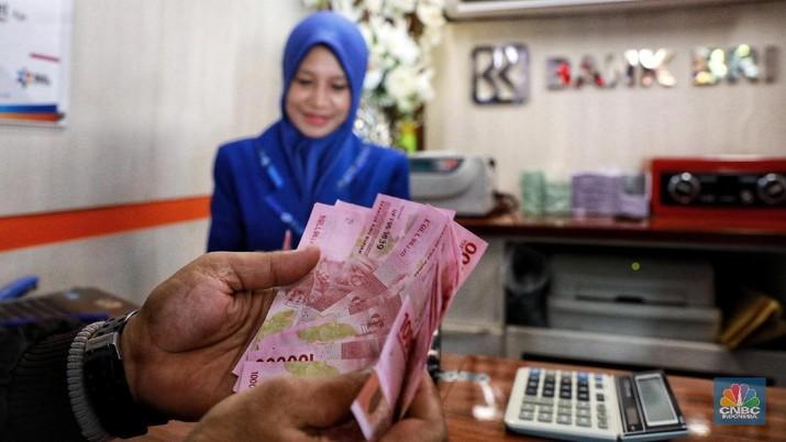 Pukul 09:00 WIB: Rupiah Pangkas Penguatan ke Rp 13.700/US$