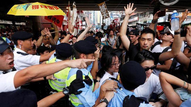 Media massa pro pemerintah China menyatakan kelompok oposisi di Hong Kong bersekongkol dengan kekuatan asing untuk menolak RUU Ekstradisi.