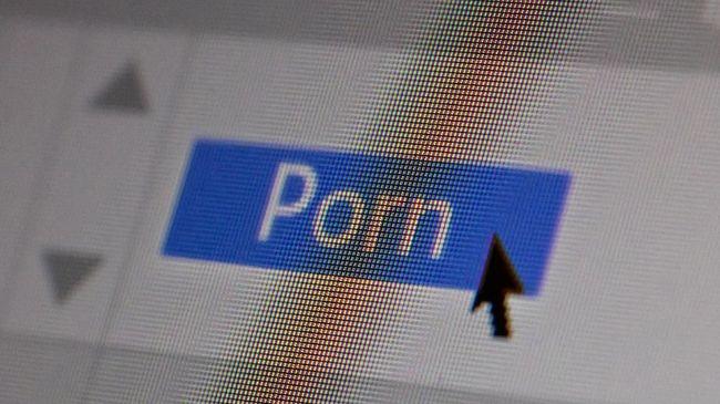 Porn text and sex content concept on computer screen. Closeup screenshot, screen pixels and cursor pointer