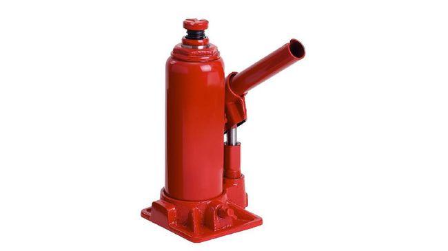 Red Hydraulic Bottle Car Jack isolated on white background